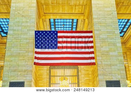 American Flag In Grand Central Terminal- Railroad Terminal In New York City.