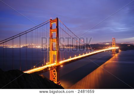Golden Gate And Bay Bridges Glow In The Dusk