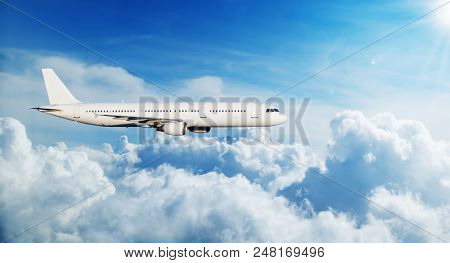 Commercial airplane jetliner flying above clouds. Transportaton and travel around the world. Fastest mode of transportation