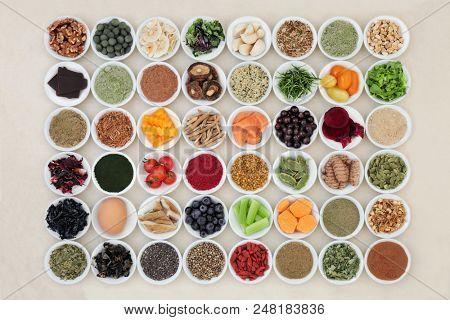 Health food for the brain with a super food collection of herbs and spices used in herbal medicine and supplement powders. High in omega 3 fatty acids, antioxidants, anthocyanins, vitamins & minerals.