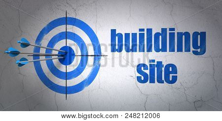 Success Construction Concept: Arrows Hitting The Center Of Target, Blue Building Site On Wall Backgr