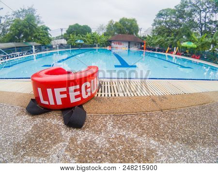 Pool Lifeguards Red Rescue Tube Near Swimming Pool