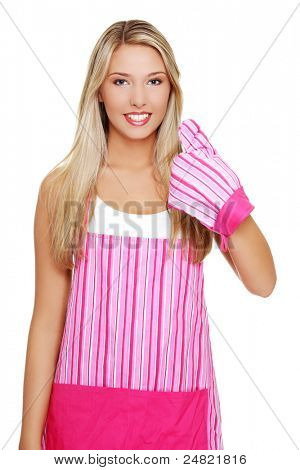 Beautiful happy young blond woman wearing kitchen apron and gesturing thumbs up, isolated on white