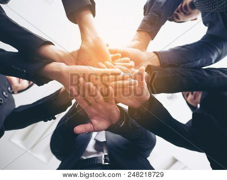 Business People Handshaking. People With Business Team Stacking Hands Together. Vintage Tone.