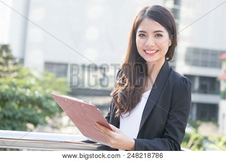 Young Beautiful Business Woman Standing In City With Success Feeling For Work. Young Business Woman