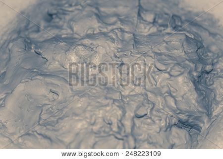 Photo In Old Vintage Style. Wet White Clay Closeup. Abstract Pieces Of Wet Clay On The Table Close-u