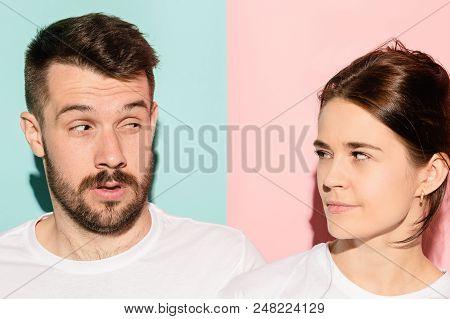 Suspicion. Doubt, Mistrust, Distrust Concept. Doubtful Man And Woman Looking With Disbelief Expressi