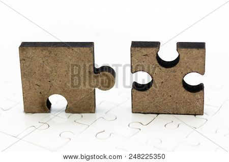 Jigsaw Puzzle Piece On The Jigsaw Board, Image Use For Solving Problems, Background Concept.