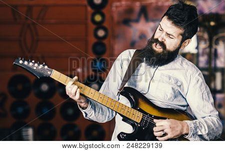 Musician With Beard Play Electric Guitar. Rock Music Concept. Talented Musician, Soloist, Singer Pla