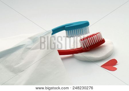 Love Concept Of Toothbrushes, Red And Blue Totbrushes Lie In Bed, Also Erotic Missionary Position In