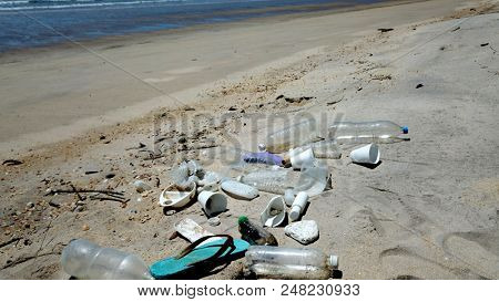 Plastic pollution on beach and ocean