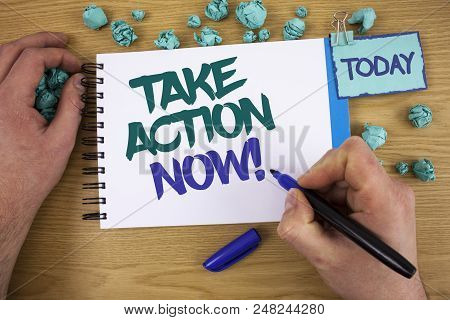 Writing note showing Take Action Now Motivational Call. Business photo showcasing Urgent Move Start Promptly Immediate Begin Text two words blue white notepad blue marker hand crumbled blue paper poster