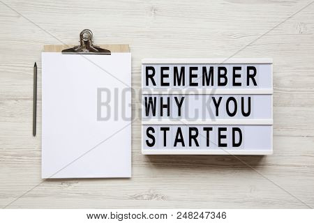'remember Why You Started' Words On Lightbox, Noticeboard, Pencil Over White Wooden Background, From
