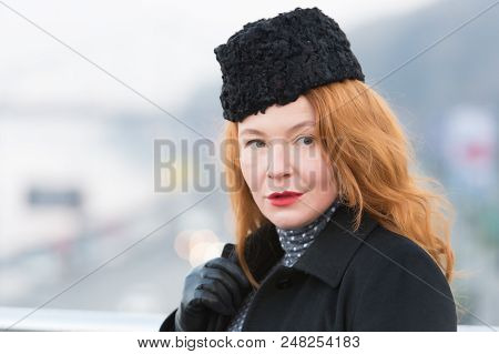 Beautiful Lady In Black Coat. Styled Lady With Rude Hair. Women Likes Black And Red. Portrait Of Wom