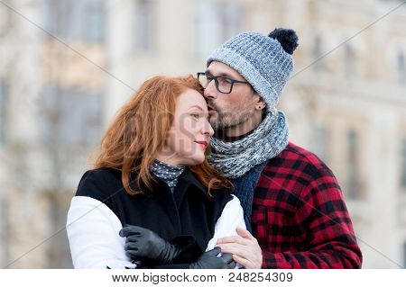 Man Kissing Woman In Forehead. Man In Glasses Kissing Woman. Guy Embracing Girl And Kiss. Urban Peop