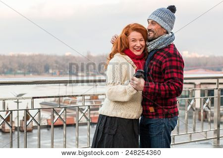 Couple Dancing On The Bridge. Smiling Happy Couple Hugging Near Of Barrier. Sweet People Love Daily