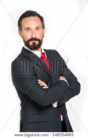 Business Man With Crossed Arms Smiling White Background. Man In Blue Suit With Red Tie Isolated In S