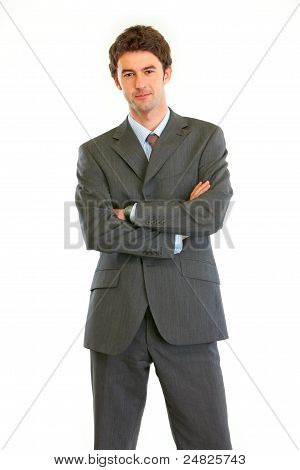 Authoritative Modern Businessman With Crossed Arms