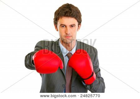 Authoritative Modern Businessman In Boxing Gloves Punching
