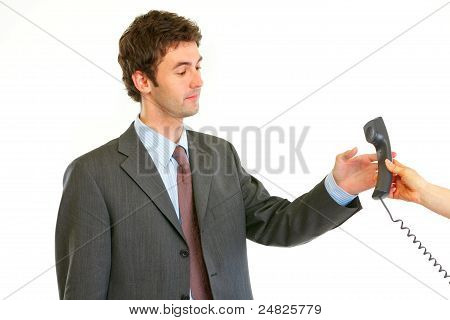 Serious Modern Businessman Taking Phone From Secretaries Hand