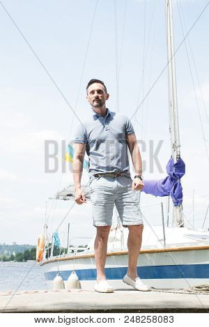 Fashion Man Portrait. River And Yachts On Background. Man Portrait Against Yachts. Sailor With Yacht