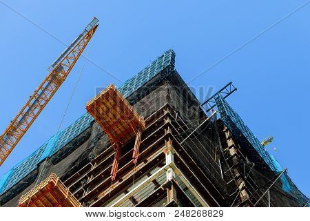 Construction Site With High-rise Crane Supplies Material To A High-rise Buildingtwo Cranes