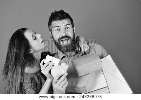 Shopping And Free Time Concept. Guy With Beard And Girl With Excited Faces Do Shopping. Man With Bea
