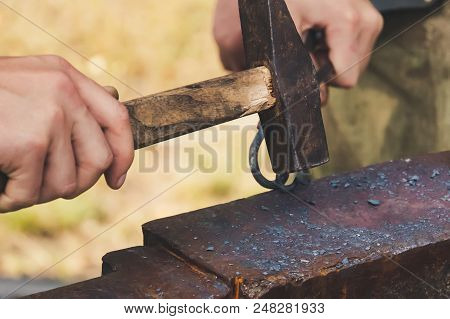 Blacksmith Forged Iron Traditional Hammer Beating. Forging Hammer Of Metal Structures In The Open Ai