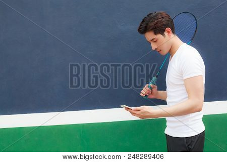 Young Athlete Man Working On Smartphone While Walking In Sport Club. Mobile Office, Freelance, Lifes