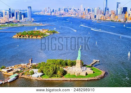 Fly over, view Statue of Liberty (Liberty Enlightening the world) near New York and Manhattan from a bird's eye view. poster