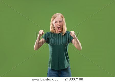 Screaming, Hate, Rage. Crying Emotional Angry Woman Screaming On Green Studio Background. Emotional,