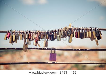 Love padlocks on a fence, Porto, Portugal.