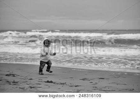 Children's Walk On The Beach. Joyful Boy Running At Beach