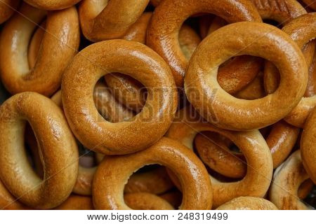 Brown Texture Of Small Round Bagels In A Heap