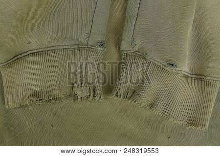 Texture Of A Fabric From Old Torn Sleeves On Clothes