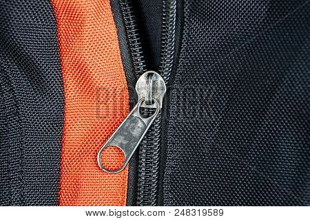 Gray Metal Buckle On A Black Red Backpack
