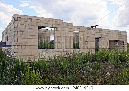 Unfinished White Brick House Against The Sky In The Grass