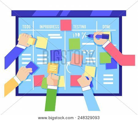 Scrum Board Concept With Human Hands Sticking Colorful Papers And Writing Tasks On Blue Board Isolat
