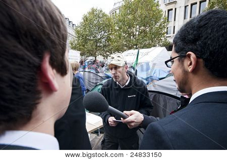 LONDON, UK -OCTOBER 31:Occupy London protesters in 'Vendetta' masks answering questions of the public on October 31, 2011 in London.