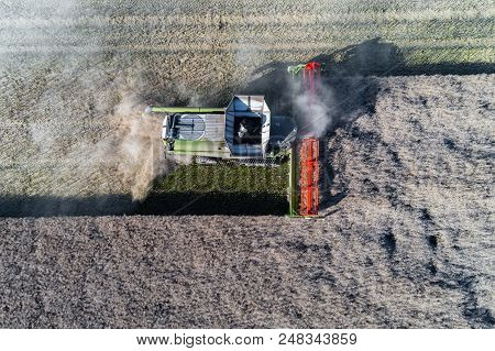 Aerial View On The Harvester Working On The Field
