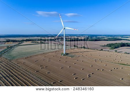 Aerial View On The Windmill On The Field With Hay Bales