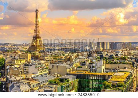Paris Sunset Skyline Aerial View From Top Of Arc De Triomphe On Champs Elysees Street. Distant Tour