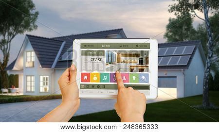 Modern home with smart home technology can be operated with a tablet via touch screen (3d rendering)