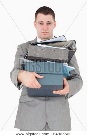 Portrait of a overwhelmed businessman against a white background