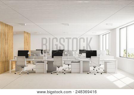 White And Wooden Open Plan Office Interior With A White Floor, Loft Windows And Rows Of Computer Tab