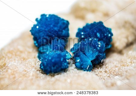 Natural Blue Stones Cavansite On A White Substrate