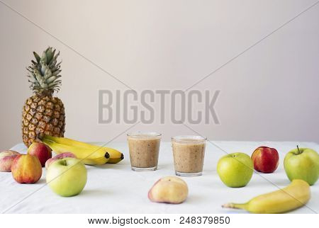 Helathy Raw Vegan Food Cooking Background. Fresh Fruits And Smoothies On Table Over White Table Clot