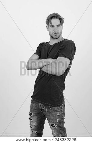 Masculinity And Confidence Concept. Man With Fair Hair On White Background. Guy In Dark Blue Tshirt