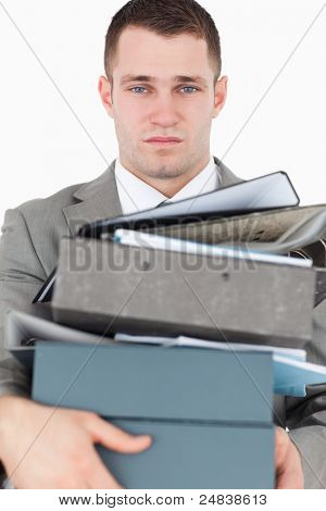Portrait of a overwhelmed young businessman against a white background