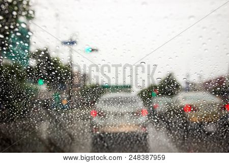 Traffic Jam During The Heavy Rain With Rain Drops On Car Glass.